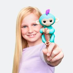 Meet Zoe.  She loves to hang upside down with her adventurous personality.  You can find her and the other Fingerlings at retrobonus.com #Fingerlings #Monkey #FingerMonkey #Toys #Fun #Cute #MomLife #Kids #Christmas #Awesome