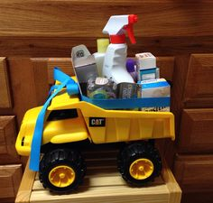 Boy baby shower dump truck gift loaded with baby essentials. I made this for my brother and sis-in-law after seeing a dump truck on their registry. I used a CAT truck but I'm sure any truck like Tonka would do, the CAT one was $10 at Walmart. I do suggest tying a ribbon top to bottom too, it was difficult to keep from tipping as it rolled on the car seat beside me lol