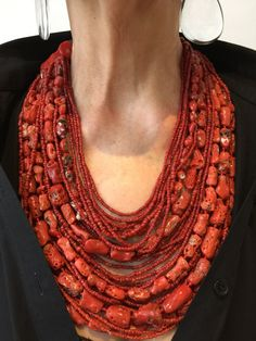 Monies Unique graduated coral necklace with coral and black leather thong fastening device. Drop from shoulder 24 cm. Black leather extension cords available. Right image shows necklace with extension cord. Very beautiful necklace. Coral Jewelry, Tribal Jewelry, Boho Jewelry, Jewelry Art, Gemstone Jewelry, Beaded Jewelry, Jewelery, Jewelry Necklaces, Beaded Necklace