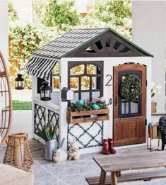 Playhouse ideas range from uncomplicated to very fancy and which playhouse blueprints you decide on will depend on multiple factors. Several years ago my wife sent away for a set of playhouse plans with the notion that I would build i Costco Playhouse, Playhouse Decor, Playhouse Interior, Modern Playhouse, Build A Playhouse, Playhouse Outdoor, Playhouse Ideas, Childrens Playhouse, Kids Outdoor Play