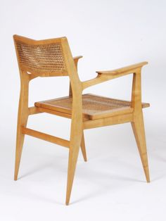 Anonymous; Fruitwood and Cane Armchair by Raphael, c1955.