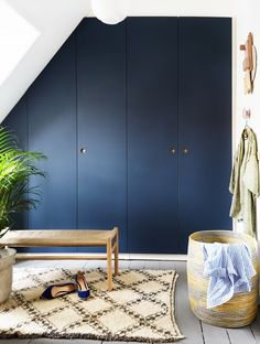 Reform Basis 01 Linoleum PAX wardrobe design on IKEA elements. Fronts in 'Smokey Blue' with handles in oak.