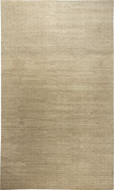 This contemporary rug is hand-knotted, un-dyed and hand-spun in wool. It features an intricate all-over design of small, densely structured geometric abstractions in darker beige against a light grayish-beige field. With its striking attention to detail and intricacy of design, the contemporary carpet captures the eye of the collector. The complete effect of the rug is evocative of modernist precision and minimalist sensibilities, and is reminiscent of renowned styles like European Art Deco…