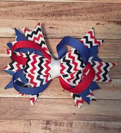 This is a handmade red, white, and blue boutique bow on a 1 3/4 alligator hair clip. The bow itself is about 5 inches wide.