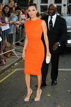 orange dress  | Eva Longoria wearing a figure hugging orange dress with sky high nude ...