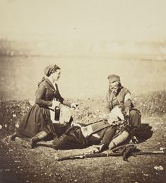 A Vivandière attends to a soldier of the Zouave regiment during the Crimean War, 5 May 1855.  Vivandières, also known as a Cantinières, were women who travelled with the French army as canteen workers. They often wore a female version of the uniform...
