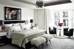 A strong photo by Daniel Gordon is all the more dramatic in this otherwise bare-walled, neutral Manhattan bedroom.   - ELLEDecor.com