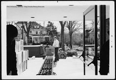 Looking out of Alden during move between Ohio University's Chubb and Alden Libraries, 1969.