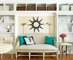 Break Up a Wall: Bookshelves along an entire wall may be too overwhelming of a view. Here, though, an oversize niche is a good spot for a comfortable love seat. In order to maximize storage, the bookshelves extend along the ceiling while baskets provide visual and textural relief.