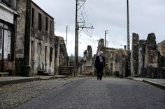 Robert Hebras, 86, survivor of the Oradour-sur-Glane massacre, is pictured visiting the village in October 2011. He was one of only six men to survive the massacre