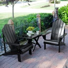 """Black Adirondack Chairs create a """"lounge"""" maybe with monogrammed pillows..."""