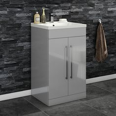 Basin and storage in one compact unit with a gorgeous Gloss Grey finish Soft-close doors shut gently and silently Polymarble basin feels smooth and resists scratches Supplied fully assembled with 1 pre-drilled tap holeLifetime manufacturer's guarantee Sink Vanity Unit, Bathroom Drawers, Bathroom Vanity Units, Bathroom Ideas, Bathroom Inspo, Grey Bathrooms Designs, Light Grey Bathrooms, White Bathroom, Compact Bathroom