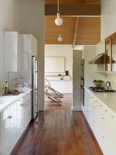 Lovely white kitchen. Leo's favorite color scheme. Jonn Coolidge mid century modern house architecture