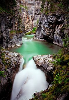 Located just 6 miles east of Jasper, Alberta, Maligne Canyon is the perfect destination to spend a couple of hours walking through creeks and bridges suspended a few inches on the majestic towering waterfalls and rapids .