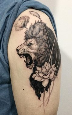 Lion and lotus tattoo - A roaring tiger on your sleeve could easily depict who you are: strong, courageous and brave. Merging it with a lotus flower tattoo on the other hand could signify your purity.