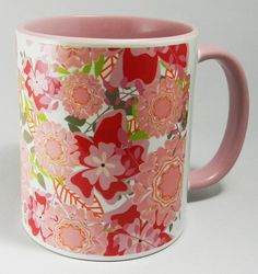 Pretty Collection of Pink Flowers Mug with pink glazed handle and inner. Designed and printed in Britain. A high quality ceramic mug which is both dishwasher and microwave proof. Height 9.5cm Diameter 8.2 cm, with a capacity of 310ml (11oz)). From the Series 9 Nature Range by Half A Donkey www.halfadonkey.co.uk