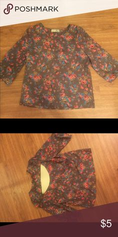 Polyester  Flower Shirt 3/4 length sleeve blouse. Cut out in back. Feel free to make reasonable offers! Everything must go! Jay Tops Blouses