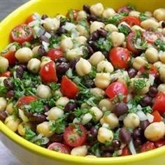 This quick Middle Eastern-style bean salad, made with garbanzo and black beans, plus lots of sweet grape tomatoes, has a tangy and slightly spicy blender dressing.