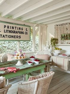 I love the use of old signage to personalize a vintage space ... and, I do have the wicker chairs around my dining table.