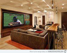 Home Theaters With Bar.  I like this idea for football games with the bar seating in the back.