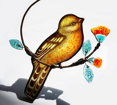 Stained glass bird made in the Gooti Glass studio