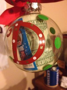 You will be the best auntie at Christmas for those college nieces and nephews.....you know all they want and need is cash..try this... Ornament with their initial stuffed with dollar bills (the amount your discretion). I like to add I little thrill and excitement to the holidays so I include a scratch off....BOOM! Best auntie Ever!