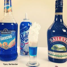 The Smurf Shot  Visit us at www.TipsyBartender.com for the recipe!