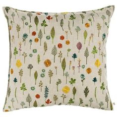 Dandy flowers, forget-me-nots, violets, sprigs and leaves dance across this gorgeous new pillow, a colorful and bright complement to any home. Fully embroidered linen cover, zips off. 90% small feather, 10% down insert. 20× 20.