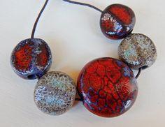 "5 beads black ceramic ""Reptile"""" By Mª Carmen Rodriguez . https://www.facebook.com/groups/CeramicArtBeadMarket"