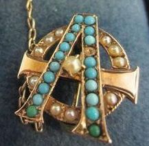 1885 - Beta Chapter (Northwestern) - Lazy Phi style Alpha Phi badge with pearls and turquoise.