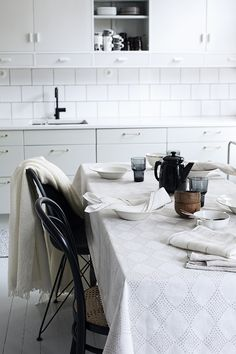 Set the table with beautiful linen, woven in Finland by Lapuan Kankurit.