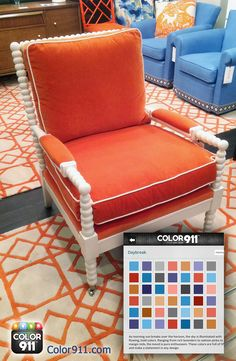 This beautiful orange chair and blue pieces in the room from #HPMKt, share the same colors as in a Color911 color theme! See what  colors inspire your design. #color #app #home #design #Color911