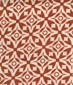 Nila Fabric A red and cream hand screen printed cotton fabric suitable for curtains and domestic upholstery.