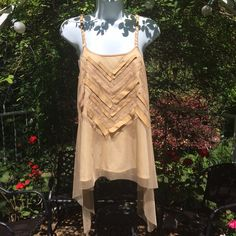 30% OFF BUNDLESThe Sand Castle Top LAST ONE Flowing beauty with vegan accents and sexy twisted strapsI'm offering 30% off 2 items or more. There's a $15 section at the bottom of my closet to help the discount kick in Tops Tank Tops