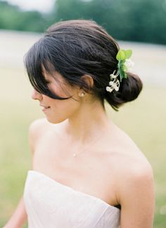 lily of the valley pinned in her hair | Jose Villa #wedding
