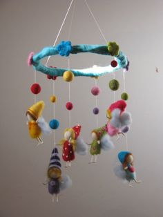 A rainbow fairies  mobile with balls, needle felted. $102.00, via Etsy.