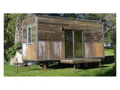 New Rustic Mobile Tiny House with wood and metal siding.