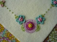 :: Blanket stitch flower embroidery inspiration :: True, it's a dramatic-looking stitch that gives good coverage and allows for variations - I ought to use it more.