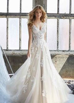 Mori Lee Bridal Kennedy 8206 is a Slim A-Line Wedding Dress Featuring an Elaborately Beaded and Embroidered V-Neck Bodice with Appliqués on English Net. Find Affordable and Exceptional Mori Lee Wedding Dresses at Ginnys Bridal Collection. Wedding Dinner Dress, Boho Wedding Dress With Sleeves, Wedding Dress Trends, Perfect Wedding Dress, Bridal Wedding Dresses, Dream Wedding Dresses, Wedding Ceremony, Wedding Venues, Wedding Ideas