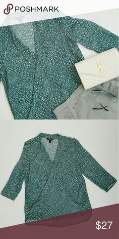 Banana Republic || Wrap Top EUC 100% Polyester  Note:  Picture three shows stock photo of the similar style. Tops Blouses