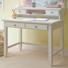 Wood desk and hutch set with 4 drawers.     Product: Desk and hutch    Construction Material: Solid wood and wo...