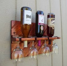 "Wall display rack - Holds 3 wine bottles and 4 glasses. Approx. 18x12"". Available in several finishes to fit any decor."