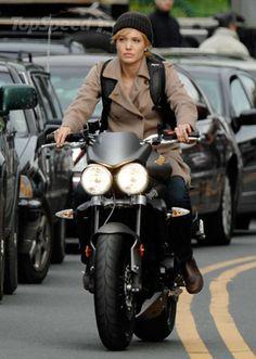 angelina jolie riding a triumph street triple