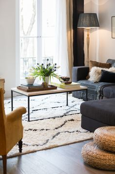 Eclectic Notting Hill home with mustard velvet armchair and souk wool rug. By Banda property. © Phil Durrant photography