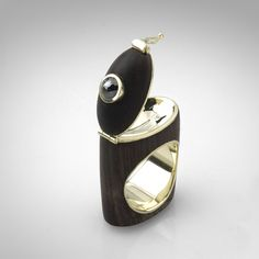 Ring made from black wood and 14K gold with black diamonds by German Kabirski