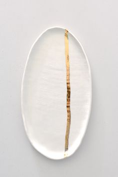 Burlap Platter in Gold Stripe, $66 | Koromiko