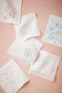 Very cute idea.  We could look for them in a vintage store in SD.  Vintage Monogram Kerchief from BHLDN