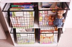 I love the idea of putting children's books in WIRE baskets.  The wire baskets make the books more visible and therefore the children would be more prone to go get a book.  Make sure to rotate the books once in a while so that new books appear at the front from time to time.