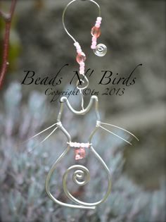 Cat Window Jewels: Cat comes with a charm necklace and decorated hanging chain. Our cats are created with love. Made with silver wire and many glass beads. Our work is made one by one and is intricate artistic wire designs. Explore light and colours in your home or garden. They are perfect for any room in your home. All of our sun-catchers come with their own hangers. $12.00 www.facebook.com/beadsbirds