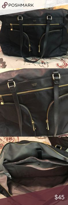 Tutilo Travel bag-NWOT! Great bag for travel, work, everyday. Holds a laptop. Has tons of space and compartments. Has a slot in back for the handle of your wheeling suitcase to go through. NWOT! Gold zippers. Awesome bag! Tutilo New York Bags Travel Bags